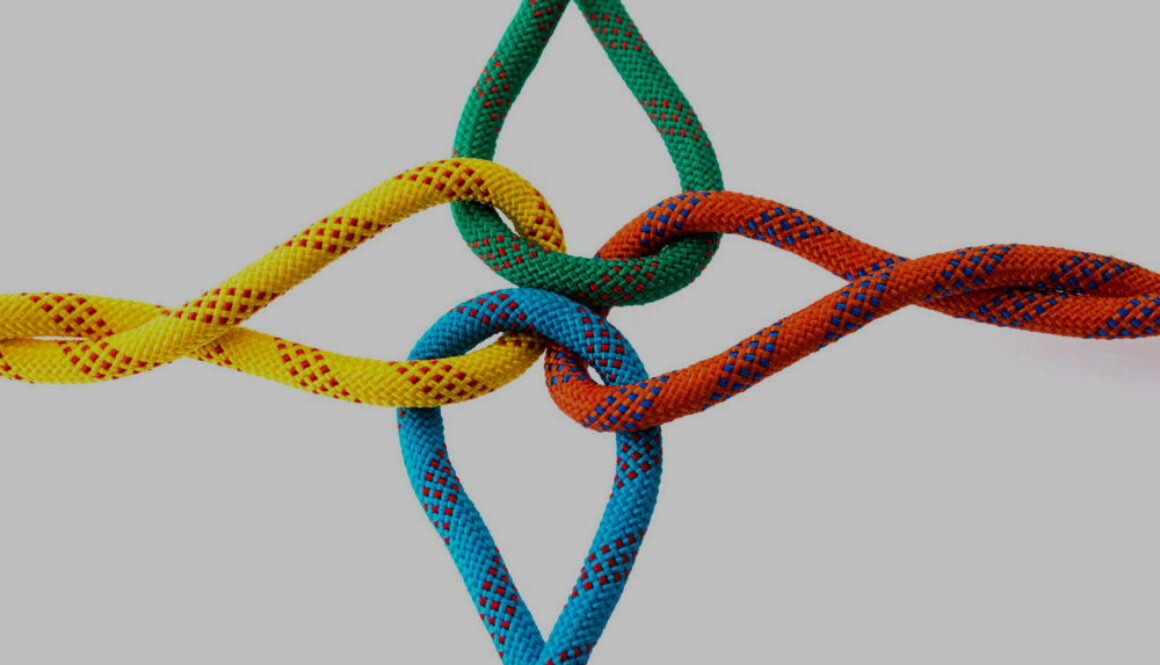 Colored ropes tied on white background